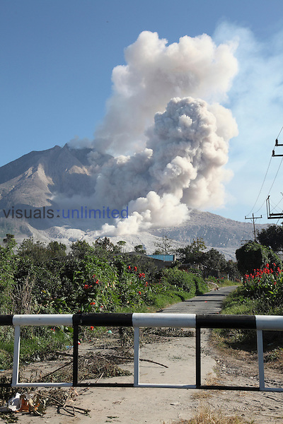 Barrier blocking road into evacuated zone around Sinabung Volcano, Sumatra, Indonesia