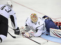 San Antonio Rampage goaltender Jacob Markstrom, right, lays on top of the puck as Rampage's Nolan Yonkman skates in to defend the net during the first period of an AHL hockey game against the Milwaukee Admirals, Tuesday, April 10, 2012, in San Antonio. (Darren Abate/pressphotointl.com)
