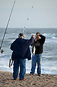 NC00588-00...NORTH CAROLINA - Surf fishing at Kure Beach.
