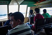 Commuters cross the river on a jetty in Kochi, Kerala, India.