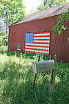Red Barn with American Flag Painted on the Barn Door