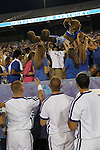 The Wildcat crowd surfs down the stands at Big Blue U at Commonwealth Stadium on August 18th, 2012. During K Week the freshman get introduced to the cheers and fight song by coaches and staff. Photo by Genevieve Adams | Staff