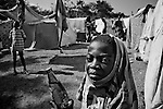 A boy stops for a picture in a camp for those displaced by the recent earthquake in Petionville, outside Port-au-Prince, Haiti.