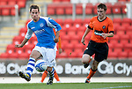 St Johnstone v Dundee United....07.08.12  SPL Under 20 League.Kevin Moon tracked by Scott Smith.Picture by Graeme Hart..Copyright Perthshire Picture Agency.Tel: 01738 623350  Mobile: 07990 594431