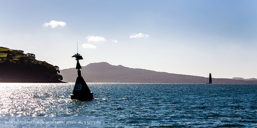 Auckland harbour, number 19 starboard buoy, looking out toward Rangitoto Island.