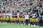 April 22, 2017; The Football team stands for the national anthem before the 2017 Blue-Gold game. (Photo by Matt Cashore)