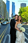 Bride and groom waltzing down 59th street in NYC prior to their ceremony..