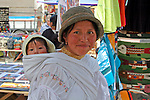 South America, Ecuador, Otavalo.  Smiles and textiles of the Otavalo Market in the Andes of Ecuador.