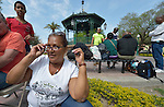 """Maira Bondejas sits in the Plaza Benito Juarez in Nuevo Laredo, Mexico, on March 3, 2017. She left her home in Cuba bound for the United States, but is now waiting close to the U.S.-Mexico border, caught in limbo by the elimination in January of the infamous """"wet foot, dry foot"""" policy of the United States. She and other Cuban refugees are not allowed to enter the U.S. yet don't want to return to Cuba. Many of the city's churches have become temporary shelters for the immigrants, and congregations rotate responsibility for feeding the Cubans. Such solidarity from ordinary Mexicans is being tested these days, as not only are the Cubans stuck at the border, but the U.S. has stepped up deportations of Mexican nationals, while at the same time detaining many undocumented workers from other nations and simply dumping them on the US-Mexico border."""