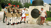 Aug 26, 2004 - Athens, Greece - Tourists run to get in position to photograph guards near the Parliament building in Athenns Thursday. Notice the guards guarding the guards at left. .(Credit Image: © Alan Greth)