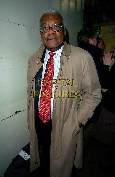 "TREVOR McDONALD.Attends ""Follies"" Gala Concert at the London Palladium,.London, England, February 4th 2007..half length red tie.CAP/CAN.©Can Nguyen/Capital Pictures"