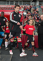 06 October 2012: D.C. United midfielder/forward Chris Pontius #13 leads his team onto the pitch during an MLS game between D.C. United and Toronto FC at BMO Field in Toronto, Ontario..D.C. United won 1-0..