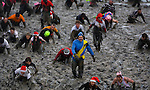 JAMES BOARDMAN / 07967642437.Competitors take part in the Maldon Mud Race in Maldon, Essex, Southern England December 27, 2009. The race originated in 1973 and involves competitors racing around a course through the River Blackwater at low tide.