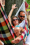 Nederland, Utrecht, 09-06-2015 Couple in a hammock along the track of the first stage of the Tour de France / Grand Depart. Foto: Gerard Til / Hollandse Hoogte