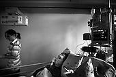 Wroclaw 02.02.2007 Poland.<br /> Michal Kozlowski,16.<br /> Clinical Hospital, oncology and haematology departmend. This is one of the important Haematologic Hospital in all over Poland, however hospital board stopped to discharge a rising debt. In this connection authorities must close hospital, but goverment had no idea what should do with terminaly ill children.<br /> (Photo: Adam Lach / Napo Images)<br /> <br /> Michal Kozlowski ( 16 lat ). Michal cierpi na chorobe Duchena, wystepujac tylko u chlopcow. Jest to choroba przewlekla i tym samym Michal bardzo czesto trafia do szpitala.<br /> Akedemicki Szpital Kliniczny, oddzial onkologii i hematologii. Temu jednemu z najwazniejszych w Polsce osrodkowi szpitalnemu grozi zamkniecie w powodu dlugow, ktore niezaleznie od wplat NFZ-tu regularnie sciaga komornik. Z calej Polski ludzie charytatywnie wplacaja pieniadze by uratowac szpital i los dzieci dla ktorych to miejsce jest jedynym ratunkiem.