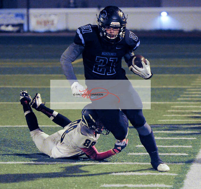 Derryk Snell evades the tackle of Service's Brandon Garoutte at Chugiak Friday, October 7, 2016.   Photo for the Star by Michael Dinneen