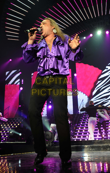 WAGNER CARRILHO.The X Factor Live tour, Wembly Arena, London, England,.March 6th 2011.performance music concert gig on stage full length purple silk satin top shirt microphone ruffle ruffles black trousers singing dancing .CAP/WIZ.© Wizard/Capital Pictures.