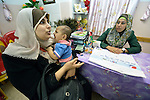 Amani Abu Sakran holds her 5-month old son Abdul as she talks with Boduor El Hellow, a counselor at a clinic in Shejaiya, a neighborhood of Gaza City that was hard hit by the Israeli military during the 2014 war. The clinic is run by the Department of Service for Palestinian Refugees of the Near East Council of Churches, a member of the ACT Alliance, and funded in part by the Pontifical Mission for Palestine. This clinic has twice been destroyed by Israeli air strikes, but each time has been rebuilt by DSPR.