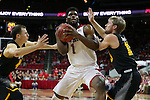 27 November 2015: NC State's Lennard Freeman (1) is defended by Winthrop's Bjorn Broman (right) and Jimmy Gavin (left). The North Carolina State University of North Carolina Wolfpack hosted the Winthrop University Eagles at the PNC Arena in Raleigh, North Carolina in a 2015-16 NCAA Division I Men's Basketball game. NC State won the game 87-79.