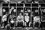 Photo by Jenna Watson<br /> In the minutes before taking the field, players scatter through the lockeroom getting in the right mindset, whether it be with horseplay or a quiet conversation.