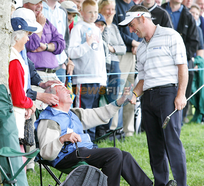Paul McGinley checks on Marshel Ulton Kerrigan after he took the force of Trevor Immelman's second shot on the forehead as Immelman played his second shot onto the green on the 6th hole during the second round of The Smurfit European Open on the Palmer course at The K Club on June 30, 2005 in Straffan, Ireland..Photo AFP/NEWSFILE/FRAN CAFFREY..(Photo credit should read AFP PHOTO FRAN CAFFREY/NEWSFILE)...This Picture has been sent you under the condtions enclosed by:.Newsfile Ltd..the Studio,.Millmount Abbey,.Drogheda,.Co Meath..Ireland..Tel: +353(0)41-9871240.Fax: +353(0)41-9871260.GSM: +353(0)86-2500958.email: pictures@newsfile.ie.www.newsfile.ie.FTP: 193.120.102.198..This picture is from Fran Caffrey@newsfile.ie