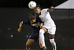29 September 2011: Duke's Natasha Anasi (right) clears the ball away from Virginia's Gloria Douglas (7). The Duke University Blue Devils and the University of Virginia Cavaliers played to a 0-0 tie after overtime at Koskinen Stadium in Durham, North Carolina in an NCAA Division I Women's Soccer game.