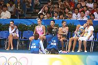 August 23, 2008; Beijing, China; (R) Rhythmic gymnast Inna Zhukova  of Belarus with coach feels the relief and happiness of winning silver in the All-Around final at 2008 Beijing Olympics. Others present are (L-R) Anna Bessonova of Ukraine, Olga Kapranova of Russia, Aliya Yussupova of Kazakhstan, Simona Peycheva of Bulgaria..(©) Copyright 2008 Tom Theobald