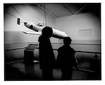 "Young Japanese take in a ""sakurahana"", kamikaze suicide airplane, at Yasukuni ""Yushukan"" (War Memorial Museum)."