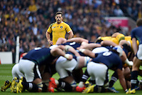 Bernard Foley of Australia watches a scrum. Rugby World Cup Quarter Final between Australia and Scotland on October 18, 2015 at Twickenham Stadium in London, England. Photo by: Patrick Khachfe / Onside Images