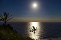 The full moon rises over Pololu Valley, Big Island.