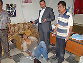 KIRKUK, IRAQ:  Brigadier General Sarhad Qadar stands over a suspect who was wounded after throwing a grenade during an attempted robbery in Kirkuk's Gold Market...The Kirkuk Regional Police, led by Sarhad Qadar, arrest the men who tried to rob the Gold Market in Kirkuk.  The suspects were all from Diyala Province, east of Kirkuk...Photo by Yaws Ibrahim/Metrography