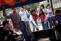 Tourists board a boat for a tour of the Golden Triangle on the Mekong River in Sop Ruak, Thailand. Photo taken on Thursday, December 10, 2009. Kevin German / Luceo Images