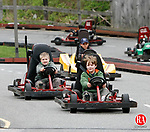 WINSTED, CT, 05/03/09- 050309BZ09- Tom Cloutier, 11, of Bristol, left, Nate Sherman, 11, of Bristol, foreground, and Colin Allaire, 11, of Bristol, background,  race go karts at R&amp;B Sports World in Winsted Sunday. <br /> Jamison C. Bazinet Republican-American