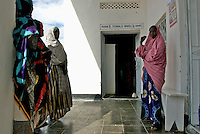 Women waiting outside the female ward at Daawad hospital in Eyl.