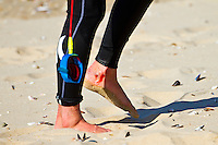 Friday July 9, 2010. Brett Simpson (USA) after his fins came in contact with his right ankle during a free surfing session at Jeffreys Bay, Eastern Cape, South Africa.  The swell is in the 5'-6' range with a howling north west devil wind. Photo: joliphotos.com