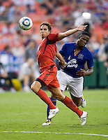 Dejan Jakovic (5) of D.C. United tries to clear the ball way from Victor Anichebe (8) of Everton during their friendly match held at RFK Stadium in Washington, DC.  D.C. United lost to Everton, 3-1.