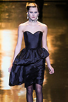 Lisanne De Jong walks runway in a black taffeta dress, from the Badgley Mischka Fall 2011 fashion show, during Mercedes-Benz Fashion Week Fall 2011.