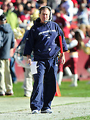 New England Patriots head coach Bill Belichick prowls the sidelines in the first quarter against the Washington Redskins at FedEx Field in Landover, Maryland on Sunday December 11, 2011..Credit: Ron Sachs / CNP.(RESTRICTION: NO New York or New Jersey Newspapers or newspapers within a 75 mile radius of New York City)