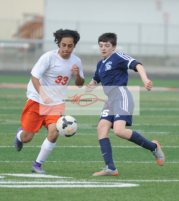 Eagle River's Nick Dubie battles for the ball in front of  his West opponent in the second half of their JV soccer contest Tuesday, April 26 at West.  Photo for the Star by Michael Dinneen