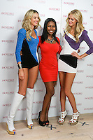 Candice Swanepoel and Erin Heatherton poses with guest during the &quot;Incredible by Victoria's Secret&quot; launch at the Victoria Secret SOHO Store, August 10, 2010.
