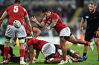 Sonatane Takulua of Tonga passes the ball. Rugby World Cup Pool C match between New Zealand and Tonga on October 9, 2015 at St James' Park in Newcastle, England. Photo by: Patrick Khachfe / Onside Images