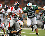 Ole Miss running back Enrique Davis (27) is tackled by Tulane safety Alex Wacha (8)  at the Louisiana Superdome in New Orleans, La. on Saturday, September 11, 2010. Ole Miss won 27-13.