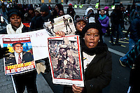 Protester - 2011<br /> <br /> London, 14/12/2011. Thousands of Congolese people, activists and supporters gathered in Great Portland Street, outside the DR Congo embassy, to begin a march to Whitehall. They continue to protest against the alleged altered result of the election in their country, and to show the ongoing violence, atrocities, mass rapes and genocide that have been committed on the armless civilians in DR Congo. The march was peaceful, contained by a heavy police presence. In Whitehall  the atmosphere became tense as some bottles were thrown on the road and a few fireworks were thrown towards police vans, though no people were injured. The deadline for the demonstration, set up by the police and the organisers, was 18.00. The march led protesters towards Trafalgar Square, escorted by police officers and dogs, where they had agreed to disperse. A small group of protesters gathered opposite Charing Cross station, but were kettled by police officers to prevent disturbances in the area.