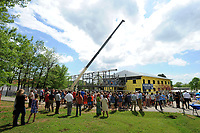 NWA Democrat-Gazette/ANDY SHUPE<br /> A large crowd of students, teachers, administrators and parents at The New School in Fayetteville gather Wednesday, April 19, 2017, to watch during a beam raising and tour of the school's expansion project in Fayetteville. The New School hopes to open the facility in the fall for the 2017-18 school year.