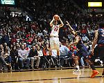 "Ole Miss' Marshall Henderson (22) shoots vs. Auburn guard Brian Greene Jr. (24) at the C.M. ""Tad"" Smith Coliseum on Saturday, February 23, 2013. Mississippi won 88-55."