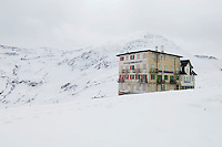 Furka Blick Hotel dating from 1893 close to the summit of the Furka Pass (2431m) connecting Uri and Valais. For the five months of the year that the pass is open, a cafe is open in the building. Photographed shortly before the road closed for a seven month winter.