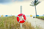 A lifebuoy or lifeguard ring buoy hangs at the ready on the beach at Bal Harbour, a village in north Miami Beach, Florida.