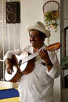 Traditional son jarocho musician performing in a restaurant in Catemaco, Veracruz, Mexico