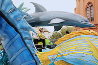 Switzerland. Canton of Neuchâtel. Neuchâtel. Grape Harvest Festival. The flower parade (corso) with its creative vehicles. A man, stripped to the waist, wears a diving mask and a snorkel. He stands up on a cart below a dolphin. © 2006 Didier Ruef