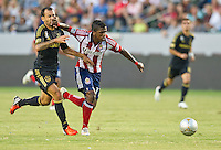 CARSON, CA - July 21, 2012: LA Galaxy midfielder Juninho (19) and Chivas USA forward Miller Bolanos (17) during the LA Galaxy vs Chivas USA match at the Home Depot Center in Carson, California. Final score LA Galaxy 3, Chivas USA 1.